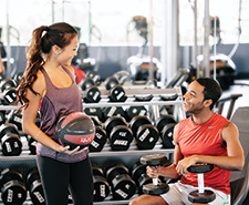 College students enjoying a fit and healthy lifestyle at the gym at The Province Rochester near Rochester Institute of Technology
