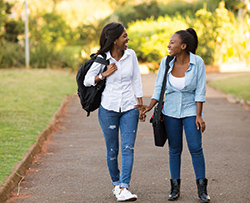 College students who live at University College at Prairie View near PVAMU walking home from class