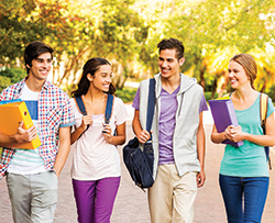 Happy students walking to class