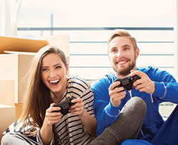 College students who live at The Townhomes at Newtown Crossing near University of Kentucky playing video games