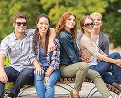 College students who live at University Walk Knoxville near University of Tennessee hanging out before class