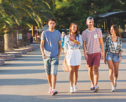 College students who live at Momentum Village near Texas A&M University Corpus Christi going on a walk.