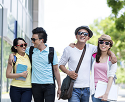 College students who live at Puerta del Sol near University of California, Irvine walking home from class